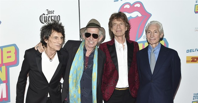 Mick Jagger avoids limelight as Charlie Watts wins award