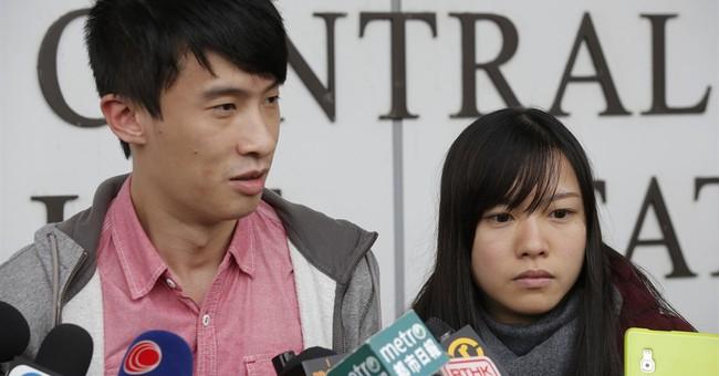 Hong Kong widens crackdown, arrests 9 more activists