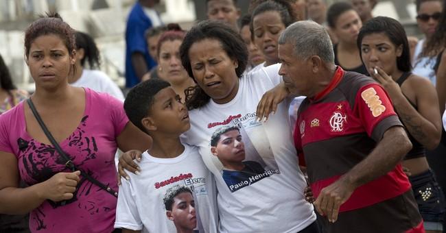 Rio slum residents bury teen, protest police-gang shootouts