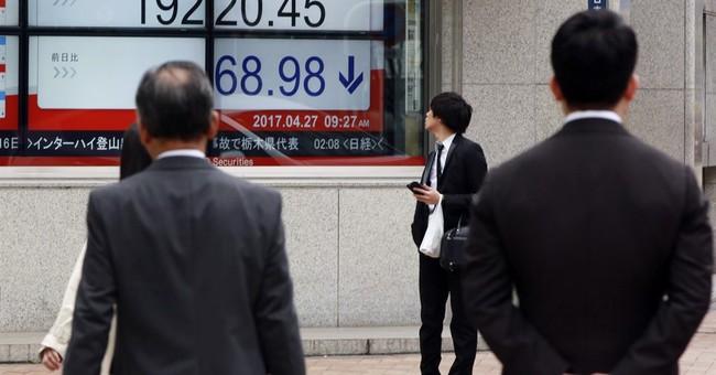 Asian stock slip as investors mull Trump tax plan