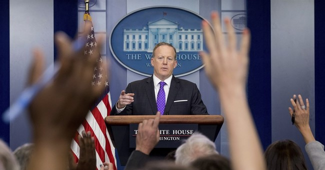 The Latest: Trump keeps mum about ousted adviser Flynn