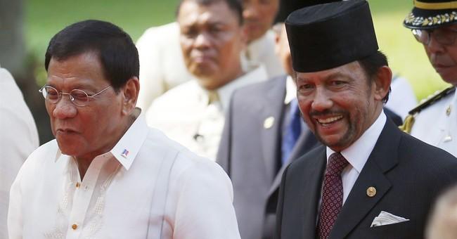 Duterte says he won't raise sea feud win vs. China in summit