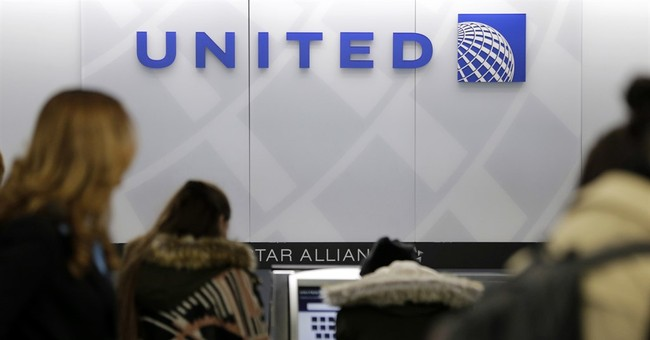 Physician dragged off flight settles with United