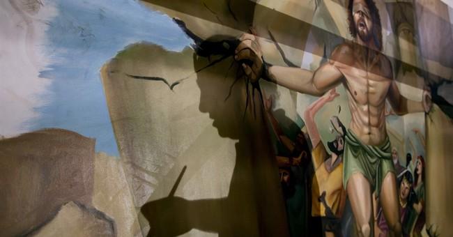 Egyptian artist paints church murals, unfazed by attacks