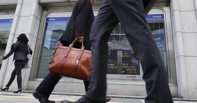 Japan economy's vital signs dull in March, but views upbeat
