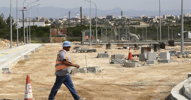 Greek, Turkish Cypriot officials tour unfinished crossing