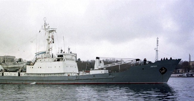 The Latest: Minor damage to freighter that hit Russian ship