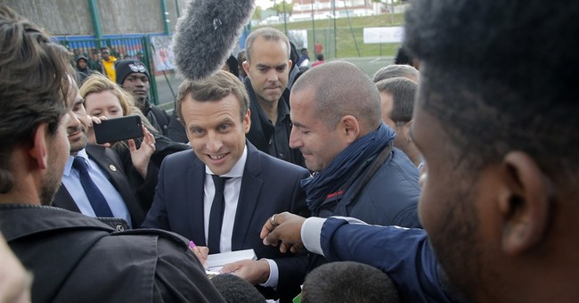 The Latest: France's Macron would keep up Mideast operations
