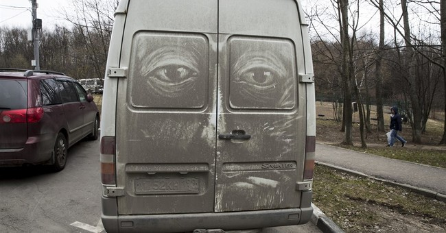 AP PHOTOS: Moscow's grimy trucks inspire street art