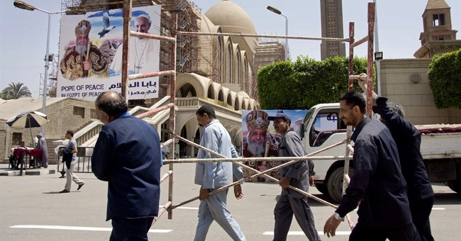 The Latest: Pope, Coptic patriarch to try to heal schism