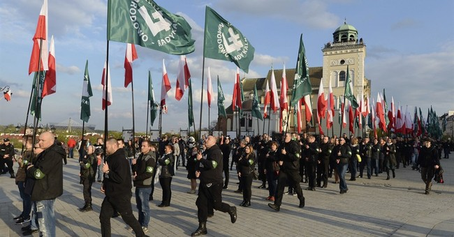Poland police forcibly remove anti-nationalist protesters