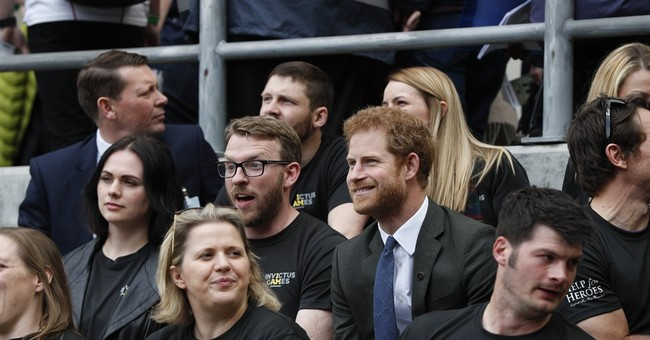 Prince Harry joins cheering fans at military rugby match