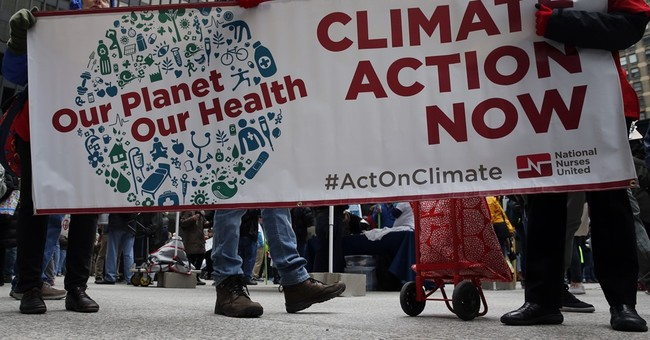 The Latest: Climate protesters in Chicago target Trump Tower