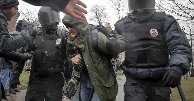 Russian rallies urge Putin not to run again; dozens arrested