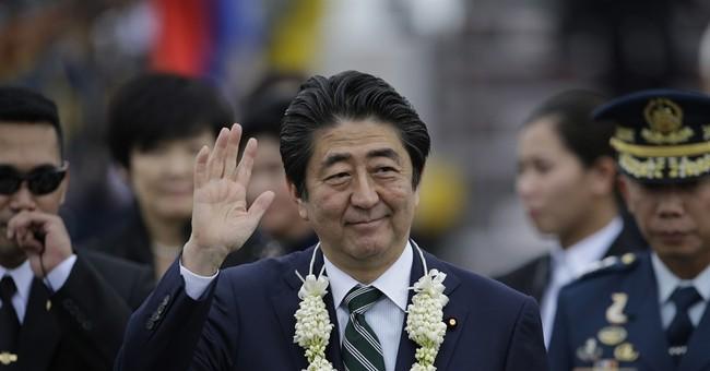 Abe pledges investments, speedboats to China-friendly Manila