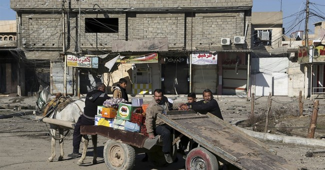 In eastern Mosul, small signs of progress amid the fighting