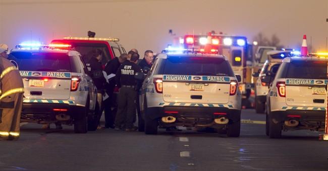 Passing driver kills man attacking Arizona trooper on road