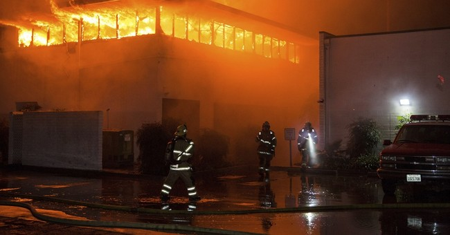 Flames spew from California fire station while crew is away