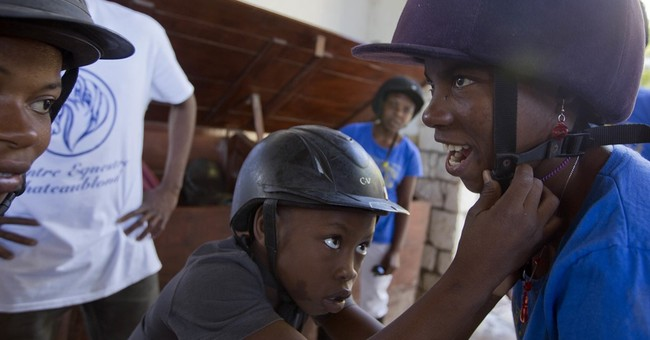 AP PHOTOS: Horse riding improves life for disabled Haiti boy