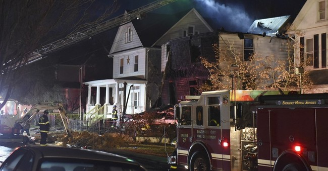 The Latest: 6 bodies recovered from home destroyed in fire