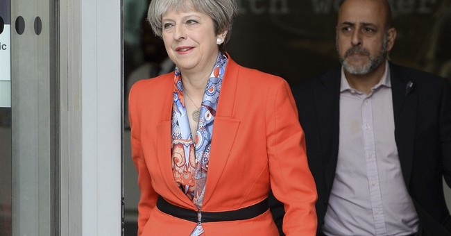 May brushes off EU calls to settle Brexit divorce bill first