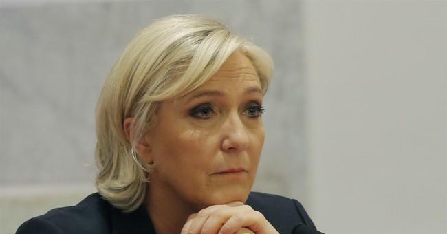 The Latest: Macron visits the Holocaust Memorial in Paris