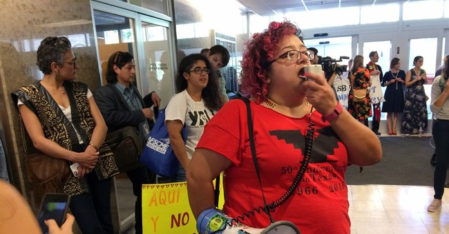 Around 20 people charged after Texas 'sanctuary city' sit-in