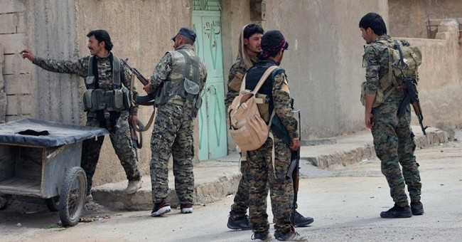 US-backed fighters retake more areas from IS in Syrian town