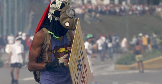 The Latest: Venezuela leader decrees constitutional assembly