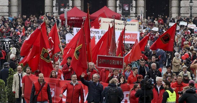 Defiant rallies for worker rights mark May Day around world