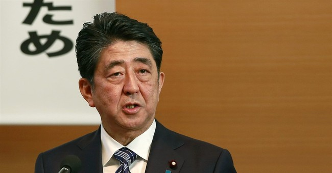 Japan PM says he will initiate debate on new constitution