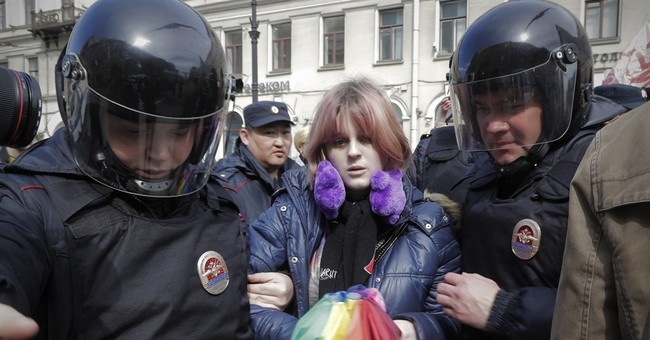 Gay activists detained in Russia at protest against torture