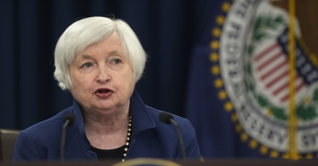 Federal Reserve keeps interest rates steady, hints at further hikes