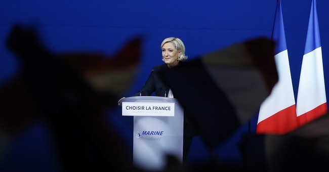 The Latest:  Le Pen wants negotiations to drop euro currency