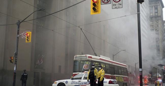 Blasts, smoke in heart of Toronto financial district