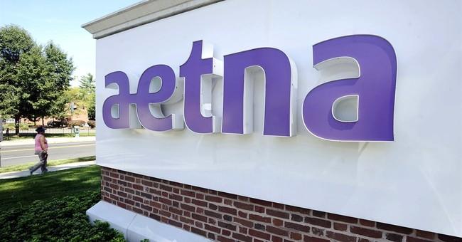 Aetna books 1Q loss on failed Humana bid, ups 2017 forecast