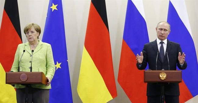Putin, Merkel spar in Russia over election meddling