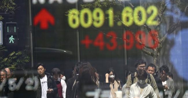 Asian shares mostly higher despite soft China factory data