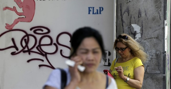 Greece agrees to new bailout terms _ and more austerity