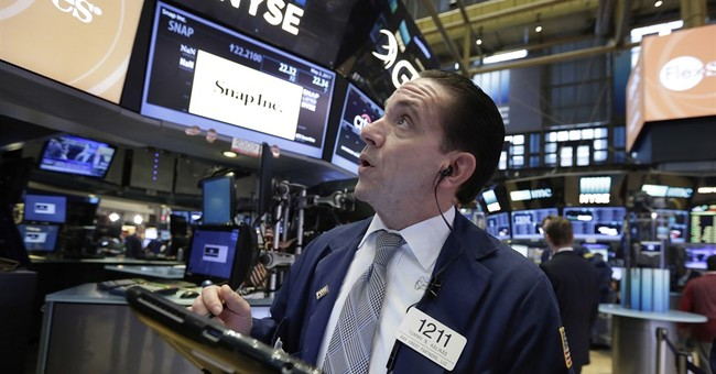 Asian stocks lower ahead of US Federal Reserve meeting