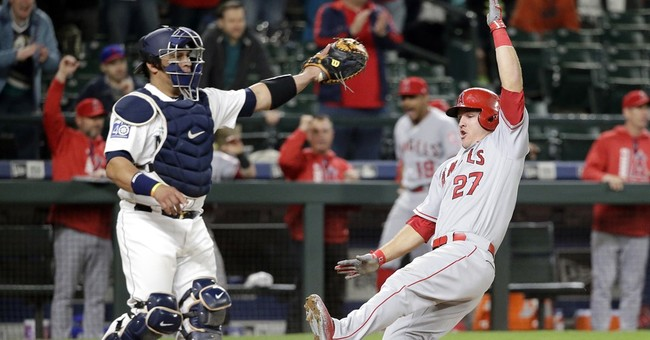 Pujols comes through in 11th as Angels beat Mariners 6-4
