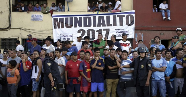 AP PHOTOS: Street soccer tournament packs Lima neighborhood