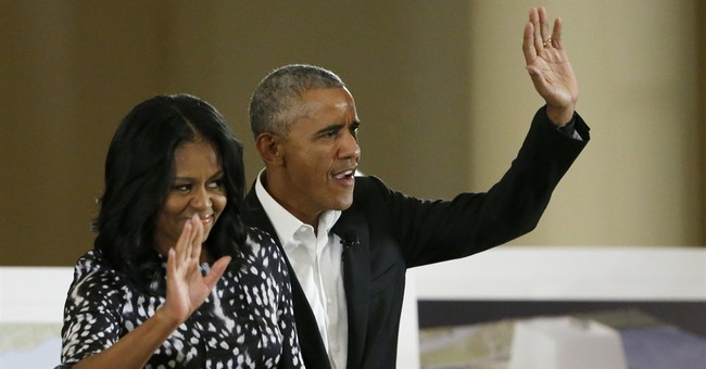The Latest: Obama says youth key to his presidential center