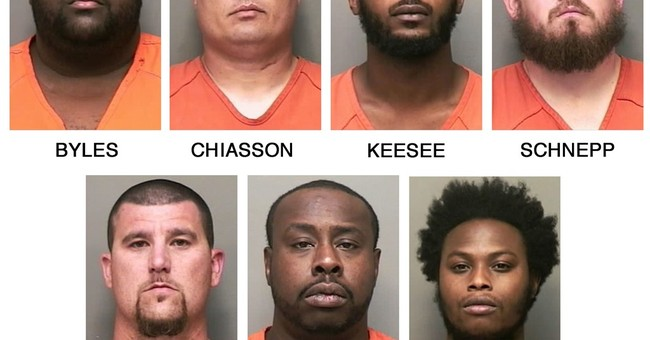 7 bounty hunters shot at wrong car, charged with murder
