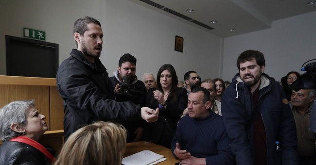 Meet the brothers fighting for indebted Greek homeowners