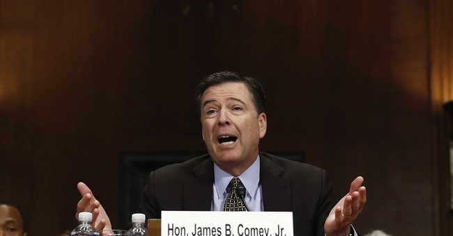The Latest: Comey says WikiLeaks isn't journalism