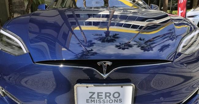 Tesla 1Q loss widens on higher spending ahead of Model 3