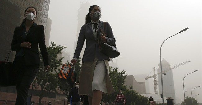 Sandstorm blankets huge area of China in dusty pollution