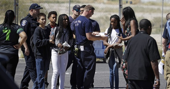 Vegas school bus crash kills car driver, injures 16 children