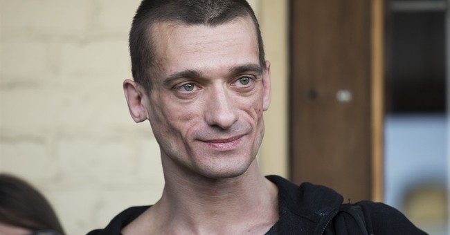 Russian performance artist says he's received French asylum